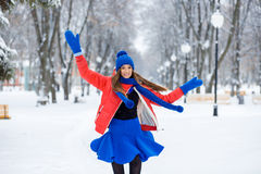 Beautiful winter portrait of young woman in the winter snowy scenery. Beautiful winter Portrait of a young woman in winter snow-covered landscape. The girl Stock Photo