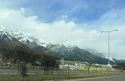 Beautiful winter rainbow over Tyrol royalty free stock photography