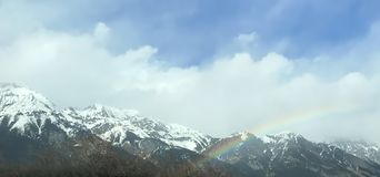 Beautiful winter rainbow over Tyrol royalty free stock photos