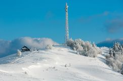 Winter hoar frosting trees,  tower and snowdrifts Carpathian mo Stock Photography