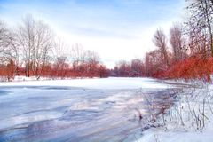 Beautiful winter rivershore. Beautiful vibrant winter icy rivershore royalty free stock photography