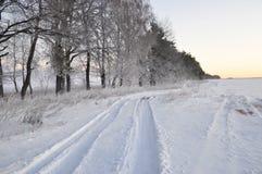 Winter road wallpaper. Snow Track Road. Beautiful winter road view. Winter road wallpaper. Snow Track Road Stock Photos