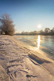 Beautiful winter scenery with trees covered by frost, along frozen river Stock Photography