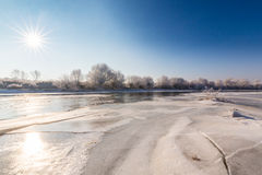 Beautiful winter scenery with trees covered by frost, along frozen river Stock Image