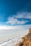 Beautiful winter seascape. Black Sea is covered with ice. Royalty Free Stock Photos