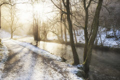 Beautiful Winter snow covered countryside landscape of river flo Royalty Free Stock Photo