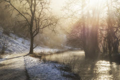 Beautiful Winter snow covered countryside landscape of river flo Stock Images