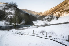 Beautiful Winter snow covered countryside landscape of river flo Royalty Free Stock Image
