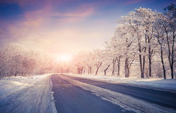 Beautiful winter sunrise on highway Stock Photos