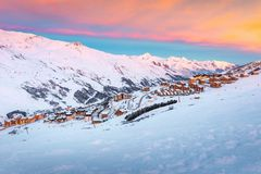 Beautiful winter sunrise landscape, famous ski resort with typical alpine wooden houses in French Alps, Les Menuires, 3 Vallees, stock photos