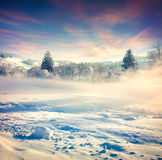Beautiful winter sunrise in the mountain village. Royalty Free Stock Photography