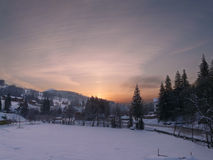 Beautiful winter sunrise in mountains. Sunset in a winter snowbound hills stock photography