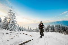 Beautiful winter sunrise portrait of young tourists Royalty Free Stock Photo
