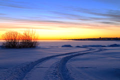 Beautiful winter sunrise with the way among the snow Stock Image