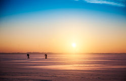 Beautiful winter sunset landscape with cross-country skiers Royalty Free Stock Photo
