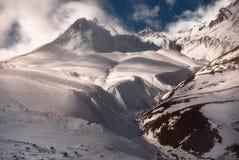 Winter sunset over caucasus mountains stock photo