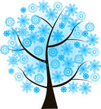 Beautiful winter tree with blue  snowflakes Royalty Free Stock Image