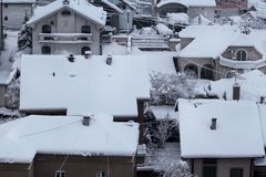 Beautiful winter view of houses and buildings with roofs covered with heavy snow. In snowy season, roof with lot snow.