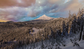 Beautiful Winter Vista of Mount Hood in Oregon, USA. Majestic View of Mt. Hood on a Stormy Sunset during the Winter months stock images