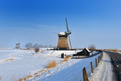 Beautiful winter windmill landscape Stock Photos