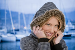 Beautiful winter woman. Beautiful young woman with winter clothes, marina in the background Royalty Free Stock Photography