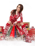 Beautiful Winter woman with christmas gifts Stock Image