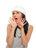 Beautiful winter woman in a hat screaming Royalty Free Stock Photos