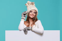 Beautiful winter woman holding a blank billboard isolated Royalty Free Stock Photography