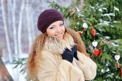 Beautiful winter woman playing with snow Stock Images