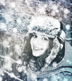 Beautiful winter woman with snow Royalty Free Stock Image