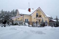 Beautiful wintery house. Beautiful house in snowy scenery of polish forest Stock Images