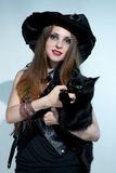 Beautiful witch with black cat Stock Image