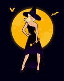 Beautiful witch in black dress Stock Photos