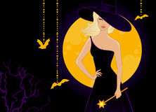 Beautiful witch in black dress Stock Image