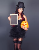 Beautiful witch in black gothic Halloween costume royalty free stock image