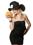 The beautiful witch in black hat Royalty Free Stock Images