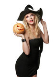 The beautiful witch in black hat Stock Photo