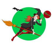 Beautiful witch on a broom. Halloween theme Royalty Free Stock Image