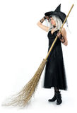Beautiful witch with broom Stock Photography