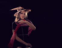 Beautiful witch on dark background Royalty Free Stock Photos