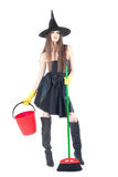 Beautiful witch doing the cleaning Stock Image