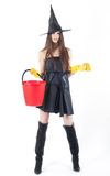 Beautiful witch doing the cleaning Royalty Free Stock Images