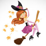 Beautiful witch flying on a broomstick Stock Photography