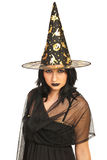 Beautiful witch with hat Stock Images