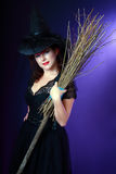 Beautiful witch hold broom Stock Images