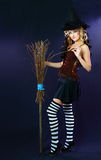 Beautiful witch hold broom Stock Photos