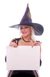 Beautiful witch holding blank paper Royalty Free Stock Image