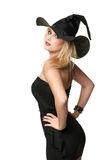 Beautiful witch holds a hat Royalty Free Stock Photography