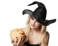 The beautiful witch holds a pumpkin Stock Photography