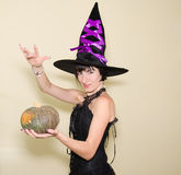 The beautiful witch and the magic pumpkin Stock Images